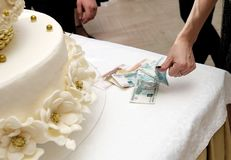 Table with wedding ring and money on it stock images