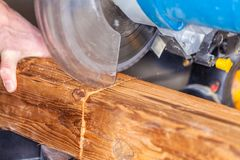 Buzz saw cuts a wood. Close up from a buzz saw cuts a wood royalty free stock image