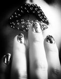Close-up BW photo of metallic lips and Minx nails Stock Photos