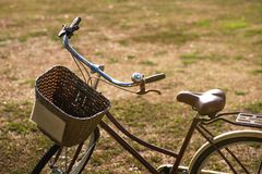 Close-up of bycicle with basket standing on ground. Easy transport for riding during travelling or vacation Stock Image