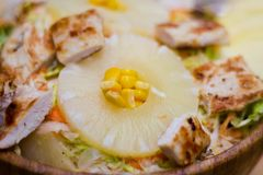 Caesar salad with pineapple stock image