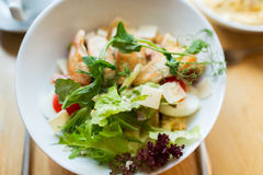 Close up of caesar salad on plate at restaurant Stock Photography