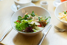 Close up of caesar salad on plate at restaurant Royalty Free Stock Photos