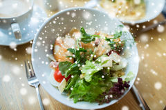 Close up of caesar salad on plate at restaurant Royalty Free Stock Images