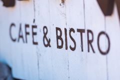 Close up on Cafe Bistro street sign royalty free stock image