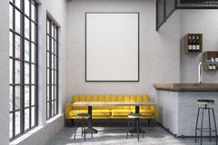 Close up of a cafe with a yellow sofa Stock Image