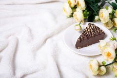 Close up of cake and flowers with copy space over white Royalty Free Stock Photo
