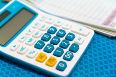 Close up of calculator and cash receipt blur in background Royalty Free Stock Image