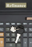 Close-up of a calculator with a house key Royalty Free Stock Photos