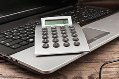 Close-up. Calculator lying on a laptop keyboard Stock Photography