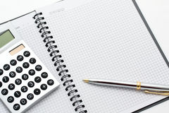 Close-up of calculator, pen and note on table Royalty Free Stock Images