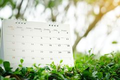 Close up of calendar on green nature background with copy space Royalty Free Stock Photography