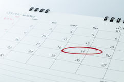 Close up of a calendar and a mark Royalty Free Stock Image