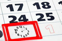 Close up of calendar page with clock Royalty Free Stock Image