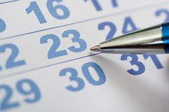 Close-up of calendar and pen Stock Image