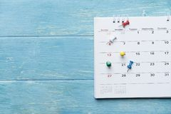 Close up of calendar on the table. Planning for business meeting or travel planning concept stock image