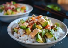 Close-up of California roll sushi bowls on dark background royalty free stock images