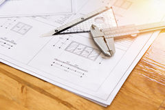 Close up of caliper with architect sketching Royalty Free Stock Photography
