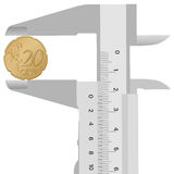 Close-up caliper and 20 euro cent. Caliper and 20 euro cent on a white background Stock Images
