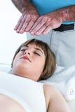 Close-up of calm woman receiving reiki treatment Royalty Free Stock Photos