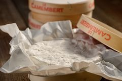 Close up on Camembert cheese. In a wooden box. Perfect white rind with creamy inner texture. Delicious French dairy food stock photos