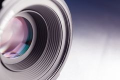Close Up Of Camera Lens. Camera lens close-up on a white-blue gradient background Royalty Free Stock Images