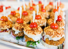 Close up of canape hamburgers on serving tray Royalty Free Stock Images