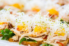 Close up of canape or sandwiches on serving tray Royalty Free Stock Image