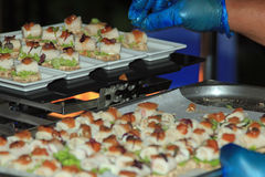 Close up of canapes being arranged at a party, reception, wedding or celebration Royalty Free Stock Image