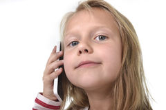 Close up candid portrait of beautiful female child with blond hair and blue eyes using mobile phone talking happy Stock Photography