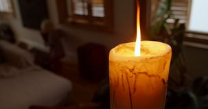 Candle burning at home 4k stock video footage