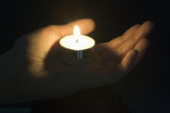 Close-Up Of Candle In The Palm Of A Persons Hand Royalty Free Stock Photos