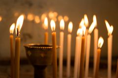 Close up of candles in a church. Faith and religion symbol Stock Image