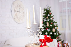Close up of candles in vintage candlestick in Christmas interior Royalty Free Stock Images