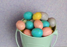 Close up of Candy Speckled Easter Eggs. Variety of Candy speckled Easter eggs in a white bucket Royalty Free Stock Images