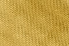 Close up of canvas painted in dark yellow royalty free stock photo