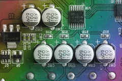 Close up of capacitor on printed computer circuit board Royalty Free Stock Photos