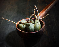Close up Caper Berries on Wooden Punch Ladle Stock Image