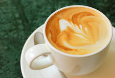 Cappuccino or latte coffee with spoon Royalty Free Stock Image