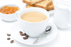 Close-up of cappuccino, milk, fresh toast and jam on white Stock Photo