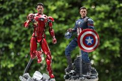 Close up of Captain America and Ironman Civil War superheros figure action stock image