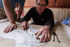 Close-up of captain charting course for sail in the Bay Stock Photos