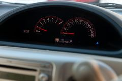 Close-up of a car dashboard backlit with a tachometer and speedometer indicating fuel level and measuring engine speed and speed royalty free stock photos