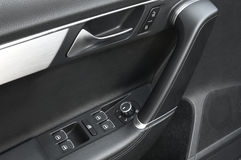 Close up of a car door handle and control pannel stock photos