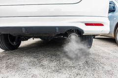 Close up of car exhaust pipe. Combustion fumes coming out of car exhaust pipe, air pollution concept Royalty Free Stock Photos
