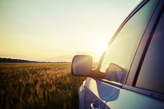 Close-up of car in field during beautiful sunset Royalty Free Stock Image