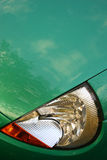 Close up of car frontview. Close up of green car front view Stock Image
