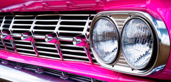 Close-up of car grill (pink Caddie). Close-up of car grill stock photography