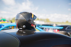 Close up of car with helmet on roof top Stock Images