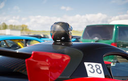 Close up of car with helmet on roof top Royalty Free Stock Photos